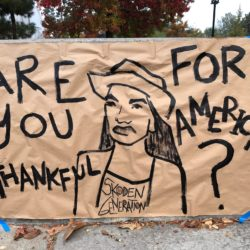 """Indigenous woman asking: """"Are you thankful for America?"""""""